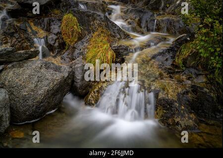 Small waterfall in mountain creek, Oberalppass, Switzerland
