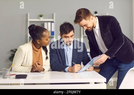 Financial advisor and biracial family couple signing contract agreement