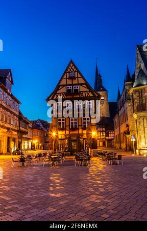 QUEDLINBURG, GERMANY, 28 JULY 2020: beautiful market square with half timbered houses at twilight Stock Photo