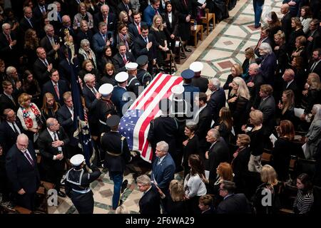 WASHINGTON (Dec. 5, 2017) The Ceremonial Honor Guard carry the casket of former President George H. W. Bush in Washington National Cathedral during Stock Photo