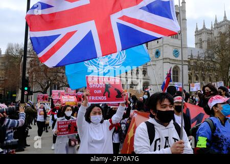 LONDON - 3RD APRIL 2021: Protesters on Parliament Square against the Chinese and Russian supported military coup in Myanmar Burma.