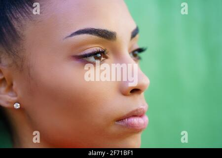 Close-up portrait of beautiful young black girl