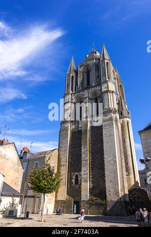 Angers, France - August 23, 2019: Tower of Abbey of Saint-Aubin fnd the Place Saint-Eloi in downtown of Angers in Maine et Loire department, France