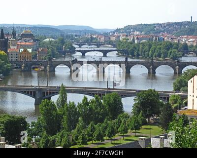 View from Letna park and Hanavský pavilon over Prague bridges and Vltava river. Famous Charles bridge is second one. Stock Photo