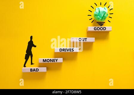 Business concept growth success process. Wood blocks stacking as step stair on yellow background, copy space. Businessman icon. Words 'bad money drive
