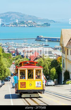 Powell-Hyde line cable car with Alcatraz Island in the background, San Francisco, California, United States of America, North America