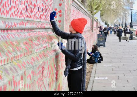 London. UK. Hearts continue to be added to the National Covid Memorial Wall at St. Thomas' Hospital Westminster, in memory of those who have died from coronavirus during the pandemic.