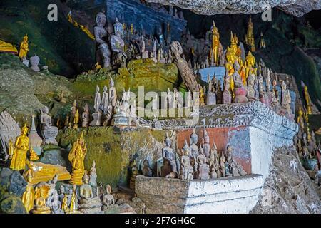 Buddha statues inside the lower cave / Tham Ting at Pak Ou Caves along the Mekong river near Luang Phabang / Luang Prabang, Laos Stock Photo