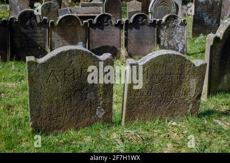 18th century gravestones in the churchyard at St Michael and All Angels Church, Taddington, Peak District National Park, Derbyshire Stock Photo