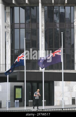 Wellington, Wellington. 10th Apr, 2021. New Zealand national flags fly at half-mast in front of Beehive, the parliament building of New Zealand, to show condolences over death of Britain's Prince Philip, in Wellington, New Zealand on April 10, 2021. Credit: Guo Lei/Xinhua/Alamy Live News