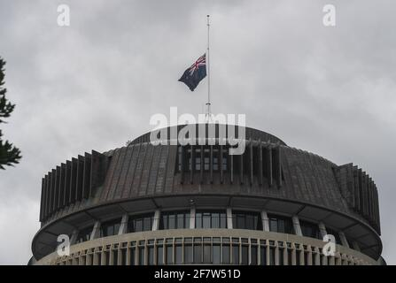 Wellington, Wellington. 10th Apr, 2021. New Zealand national flag flies at half-mast on top of Beehive, the parliament building of New Zealand, to show condolences over death of Britain's Prince Philip, in Wellington, New Zealand on April 10, 2021. Credit: Guo Lei/Xinhua/Alamy Live News