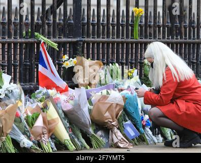 London, UK April 10th 2021. People queued up to lay flowers and pay their respects outside Buckingham Palace in tribute to HRH Prince Philip, who died on Friday at the age of 99, just 2 months short of his 100th birthday. Monica Wells/Alamy Live News