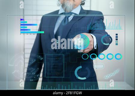 A businessman works on a Touchscreen Interface with Technology in business data. Futuristic style, on blue background.