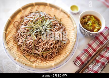 Soba noodles on bamboo tray, use with featured soy sauce