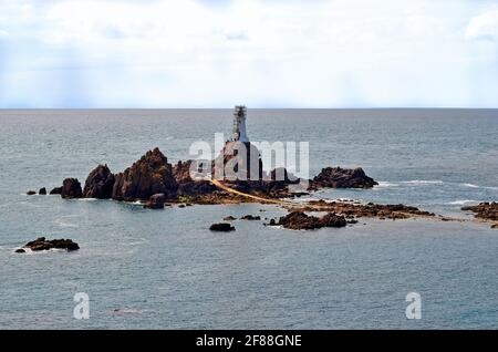 UK, Jersey, lighthouse with causeway in La Corbiere, reachable only at low tide