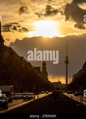 Berlin, Germany. 12th Apr, 2021. During sunset, a dark cloud moves behind the TV tower. Credit: Christophe Gateau/dpa/Alamy Live News