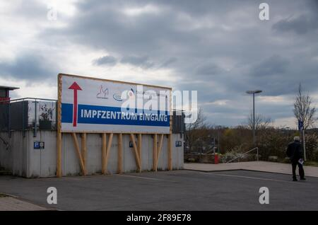 Bamberg, Germany - 10.4.2021. A large sign points the way to the Vaccination Centre of Bamberg. Stock Photo