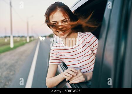 woman in striped t-shirt red hair car window salon model