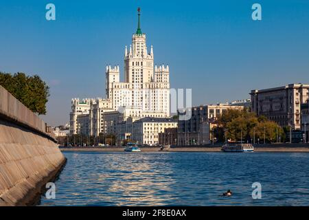 View of one of the Stalin's skyscrapers in Moscow from the embankment of the Moscow River.