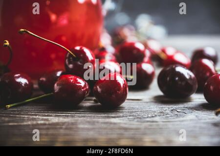 Ripe and juicy cherries on the dark rustic background. Selective focus. Shallow depth of field.