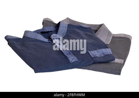 Denim shirts isolated. Close-up of a stylish striped blue jeans shirt and a gray striped polo shirt for mens isolated on a white background. Macro of
