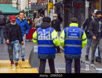 London, United Kingdom. 14th April 2021. Covid Marshals in Old Compton Street, Soho. Marshals have been deployed in the busy streets of Soho to support the public in observing the social distancing rules.
