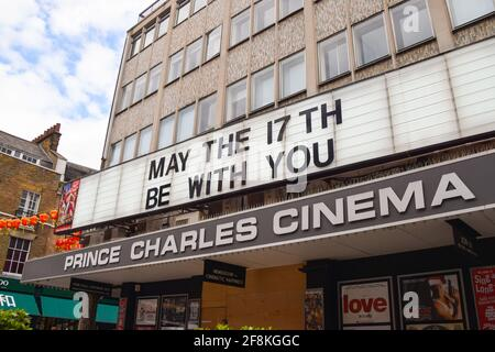 London, United Kingdom. 14th April 2021. 'May The 17th Be With You' on the marquee at Prince Charles Cinema, West End. Cinemas in the UK are due to reopen on 17th May.