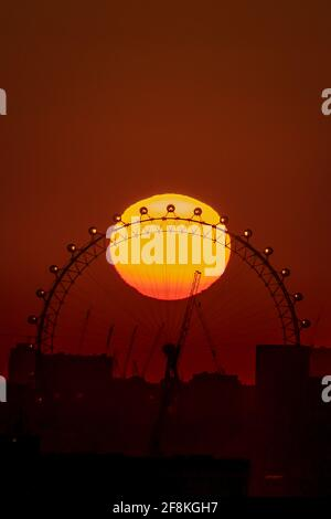 London, UK. 14th April, 2021. UK Weather: Dramatic evening sunset over the The London Eye ferris wheel as the city prepares for a mini-heatwave. Credit: Guy Corbishley/Alamy Live News