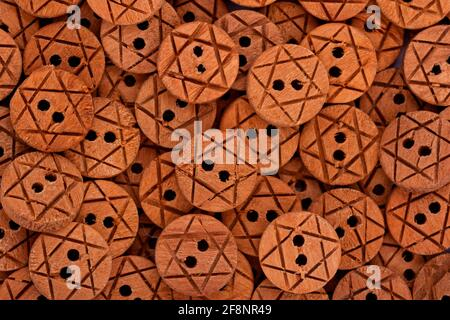 Wooden raw button close up background