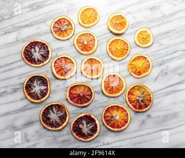 Dried Blood Oranges on White Marble