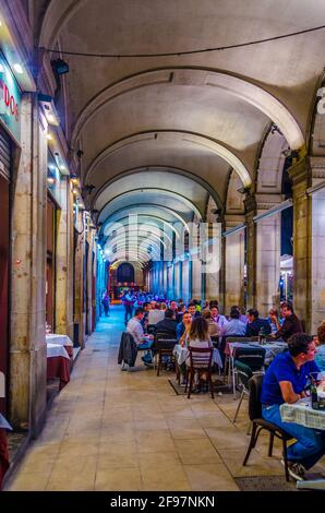 View of an arcade at the Placa Reial  in Barcelona, Spain.