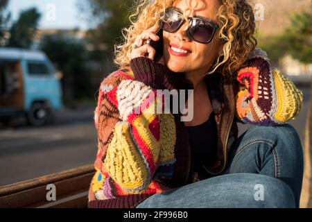 Portrait of cheerful happy beautiful woman doing phone call in sunny day outdoor leisure travel activity alone - concept of joyful pretty female in summer spring lifestyle smiling