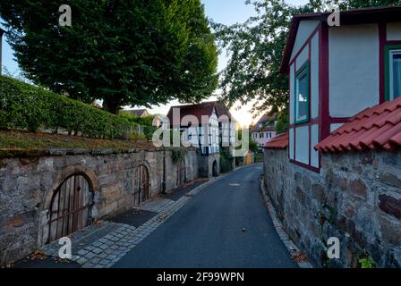 City wall, city fortifications, cellar house, facade, half-timbered, alley, architecture, Haßberge, Ebern, Franconia, Bavaria, Germany, Europe