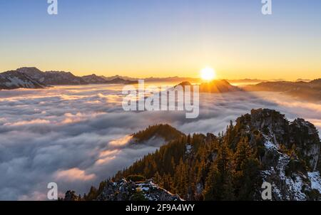 View from Sorgschrofen over sea of fog at sunset in winter. Allgäu Alps, Bavaria, Germany, Europe Stock Photo