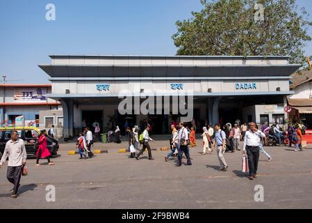 People outside the entrance of the Dadar Terminus in Mumbai, Maharashtra, India,Asia. Stock Photo