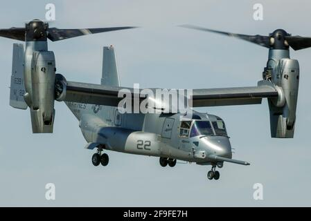 Bell Boeing MV-22B Osprey tilt rotor flying a demonstration at an airshow. US Marine Corps version of V-22 design. Early metallic paint scheme - Stock Photo