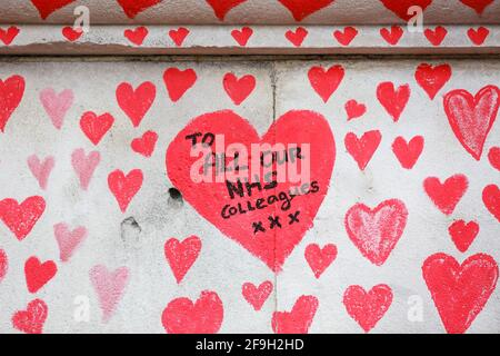 London, UK. 13 April 2021. The National COVID Memorial Wall - hand drawn red hearts on a wall opposite Houses of Parliament. Credit: Waldemar Sikora