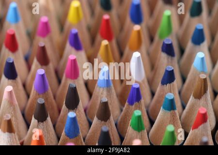 Closeup of many multicolored sharp wooden pencils