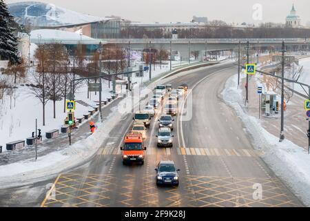 Moscow, Russia - January 17, 2021: View of the Moskvoretskaya embankment, cars and a skyscraper on Kotelnicheskaya embankment on a frosty winter morni