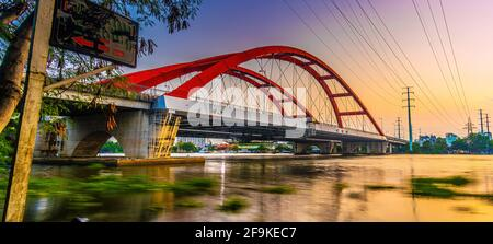 Beautiful sunset on Binh Loi Bridge new and old by night in the rush hour, Ho Chi Minh City, Vietnam. Travel and landscape concept.