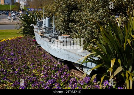 A retired remote controlled battleship used in the naval warfare shows at Peasholm Park in Scarborough, now sits on a roundabout outside the park.