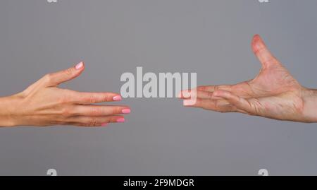 Helping hand. Two hands. Support in relationships. Solidarity, compassion, and charity concept.