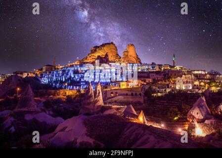 Uchisar Castle at night. It`s small, but beautiful town in Cappadocia, Turkey near Goreme. One of the best viewpoints to the valley. Colorful lights.