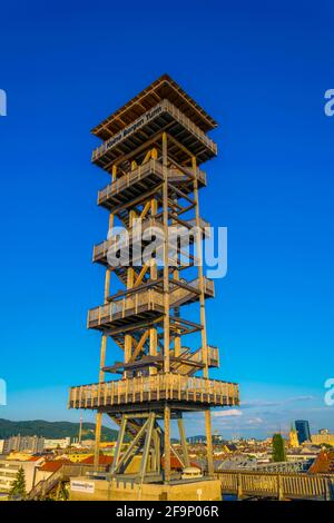 view of a wooden lookout tower situated on the top of a building in the central Linz, Austria.