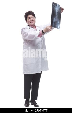in full growth. a smiling female doctor examining an x -ray of a patient