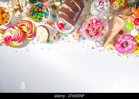 Selection of colorful sweets. Set of various candies, chocolates, donuts, cookies, lollipops, ice cream top view on white background