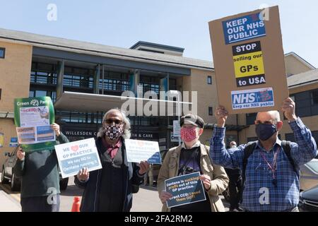Willesden, London, UK. 22nd April 2021. Local protesters demonstrating outside Willesden Centre for Health & Care against the takeover of General Practice surgeries by Operose Health, owned by Centene, a US health company.  It is one of many London wide demonstrations, campaigning against the takeover of 49 GP practices in England by Centene, a private health company based in the United States.  The US Centene Corporation has bought up 49 London GP practices that look after 375,000 patients is now the largest GP practice network in the UK.   Amanda Rose/Alamy