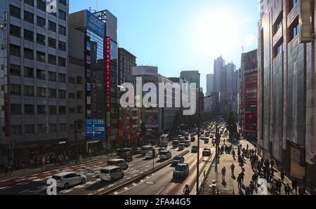 Tokyo, Japan - October 20 2020: Afternoon view of a busy boulevard lined with high-rises in central Tokyo on a sunny day