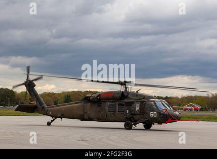 Easton, Maryland, USA, 04-16-2021: A Sikorsky UH-60 Black Hawk Helicopter is getting ready for take off by starting the engines and propellers at an a Stock Photo