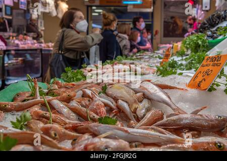 Palma de Mallorca, Spain; april 23 2021: Shoppers and vendors wearing facial masks at a fish market in the traditional Mercado del Olivar. New normali